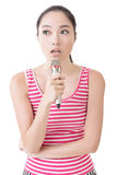 Asian girl take a microphone singing or speak Stock Photography