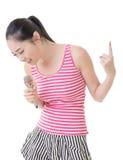 Asian girl take a microphone singing or speak Royalty Free Stock Image