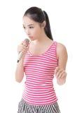 Asian girl take a microphone singing or speak Stock Image