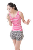 Asian girl take a microphone singing or speak Royalty Free Stock Photography
