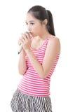 Asian girl take a microphone singing or speak Stock Photos