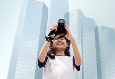 Asian girl take photo in city. Asian girl take photo with camera in modern urban city outdoor Royalty Free Stock Photography