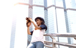 Asian girl take photo in city. Asian girl take photo with camera in modern urban city outdoor Stock Photo