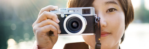 Asian Girl Takin Pictures By Camera Concept Stock Image