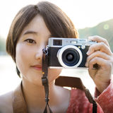 Asian Girl Takin Pictures By Camera Concept Stock Photos