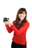 Asian girl taking photo with a compact camera looking at the cam Royalty Free Stock Photo