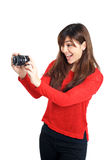 Asian girl taking photo with a compact camera Stock Images