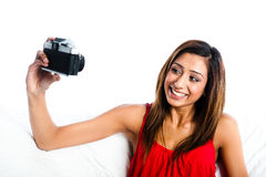 Asian girl taking photo of herself smiling Stock Photos