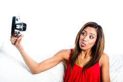 Asian girl taking photo of herself with tongue Stock Images