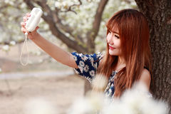 Asian girl taking pictures stock photo