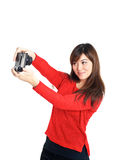 Asian girl taking a selfie with compact camera Royalty Free Stock Photo