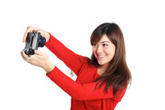 Asian girl taking a selfie with compact camera Stock Photography