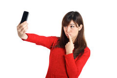 Asian girl taking a selfie with her phone Royalty Free Stock Images