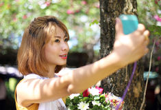 Asian girl taking selfie photo Stock Images