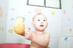 Asian girl taking a shower Royalty Free Stock Images