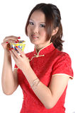 Asian girl with tea cup Royalty Free Stock Photos