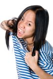 The Asian girl tears a frock Royalty Free Stock Photo