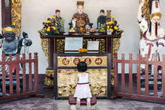 Child praying in Temple Royalty Free Stock Image