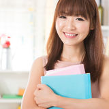 Asian girl with textbooks Stock Photography