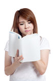 Asian girl think and reading book Stock Image