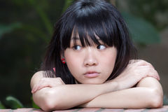 Asian girl thinking Stock Images