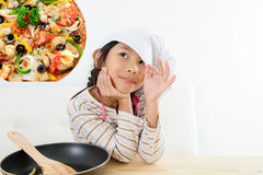 Asian girl thinking about pizza, food Royalty Free Stock Images