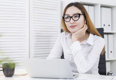Asian girl thinking about success Stock Photos