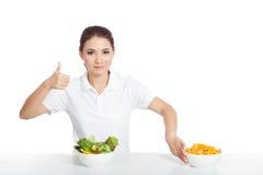 Asian girl thumbs up for salad push crisps away Stock Photography