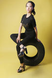 Asian girl and tire Stock Photography