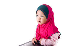 Asian Girl toddler using tablet with isolated background Royalty Free Stock Images