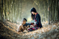 Asian girl took her brother happily listening to the radio. Asian girl took her brother happily listening to the radio Stock Images