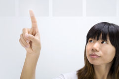 Asian girl touch screen Royalty Free Stock Photography