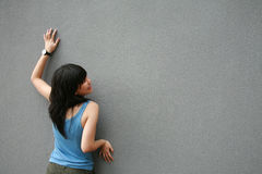 Asian girl touching wall Stock Photo