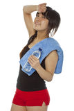 Asian girl with towel and bottle of water Royalty Free Stock Photography