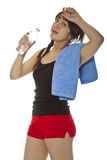Asian girl with towel and bottle of water Stock Images