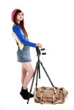 An Asian girl with the tripod. And bag Stock Images