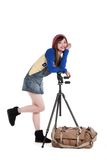 An Asian girl with the tripod Royalty Free Stock Photos