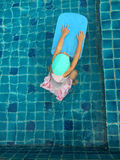 Asian girl try to swimming at swimming pool Royalty Free Stock Images