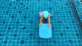 Asian girl try to swimming at swimming pool Royalty Free Stock Photo