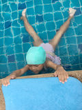 Asian girl try to swimming at swimming pool Stock Images