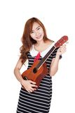 Asian girl tune ukulele Stock Photography