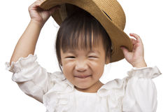 Asian girl two years old wearing a hat. Stock Photos