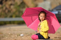 Asian girl and Umbrella Stock Image