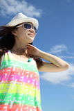 An Asian girl under the blue sky Royalty Free Stock Photo
