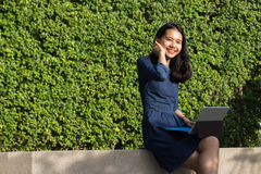 Asian girl use laptop for searching outdoor. Asian girl use laptop for searching and connecting data unplug lifestyle royalty free stock images