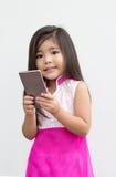Asian girl use mobile Royalty Free Stock Photos