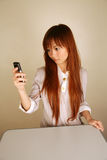 Asian girl using her mobile phone stock photo