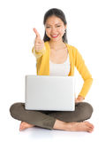 Asian girl using laptop pc and thumb up Royalty Free Stock Photography