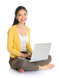 Asian girl using notebook computer Royalty Free Stock Photo