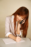 Asian girl using phone Royalty Free Stock Images